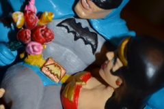 Batman Wonder Woman above